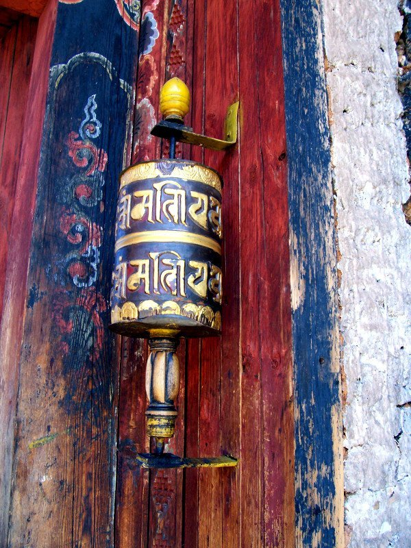 Prayer Wheel at doorway of side door at one of the Best Places To Visit In Thimphu Bhutan, an ancient temple named Changangkha Lhakhang