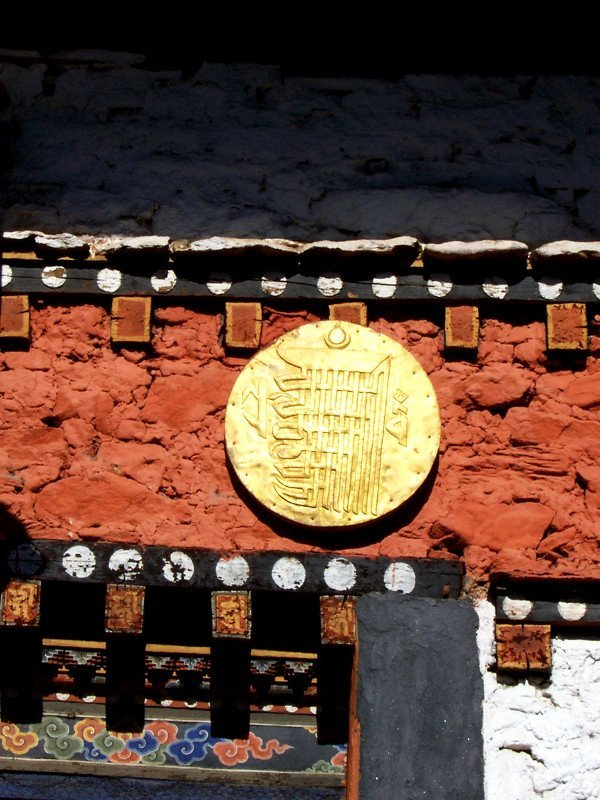 Kalachakra symbol in gold at one of the Best Places To Visit In Thimphu Bhutan, an ancient temple named Changangkha Lhakhang