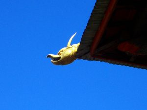 Close up of the gold heavenly creature that decorates the rooftops of one of the Best Places To Visit In Thimphu Bhutan, an ancient temple named Changangkha Lhakhang