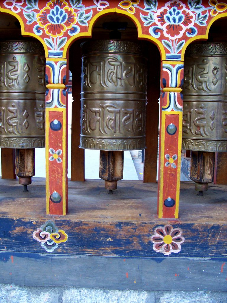 Things To Do In Thimphu Bhutan - Closer View of Traditional Bhutanese Mani Lhalhor (Prayer Wheels) that are located at the Clock Tower Square in Thimphu, Bhutan