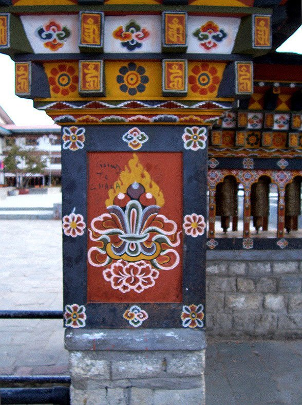 Things To Do In Thimphu Bhutan - Traditional Bhutanese Mani Lhalhor (Prayer Wheels), close up view of traditional Bhutanese art