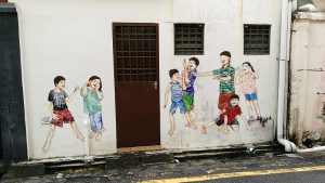 Things To Do In Ipoh - Mural Art of a group of children playing blind man's buff - this is one of the famous murals