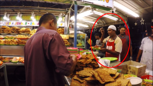 Famous Stall with Guy Who Sings and Dance as he prepares the food