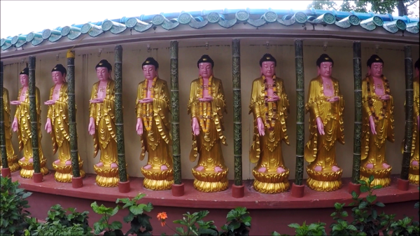 Many statues of Buddhas adorn the perimeter of one of the prayer halls
