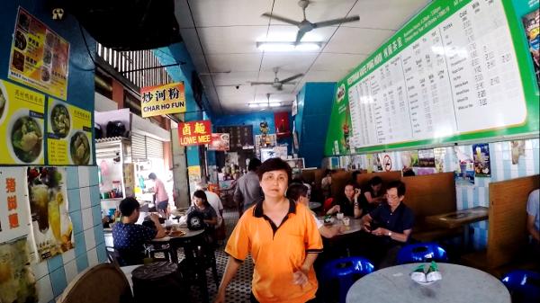 Server at Tiger Char Koay Teow