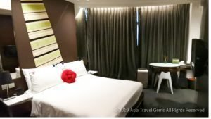 Deluxe Room Bed at Butterfly On Morrison