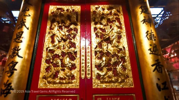 Beautiful panels and pillars in red and gold greet you as you enter Man Mo Temple