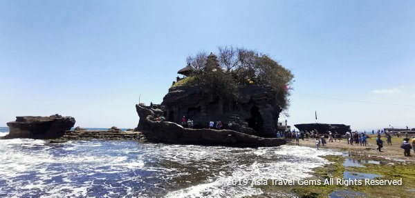 Tanah Lot Temple Built On Rock At Edge Where Shore Meets The Sea